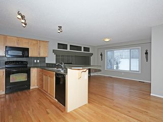 Photo 8: 89 SUNSET Heights: Cochrane House for sale : MLS®# C4177018