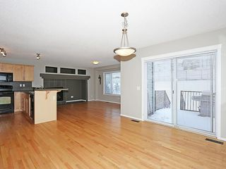 Photo 10: 89 SUNSET Heights: Cochrane House for sale : MLS®# C4177018