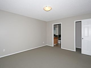 Photo 19: 89 SUNSET Heights: Cochrane House for sale : MLS®# C4177018