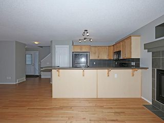Photo 4: 89 SUNSET Heights: Cochrane House for sale : MLS®# C4177018