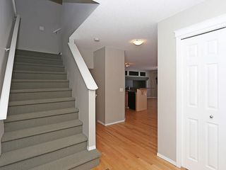 Photo 2: 89 SUNSET Heights: Cochrane House for sale : MLS®# C4177018