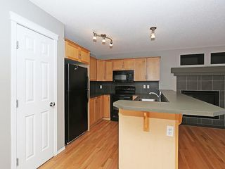 Photo 5: 89 SUNSET Heights: Cochrane House for sale : MLS®# C4177018