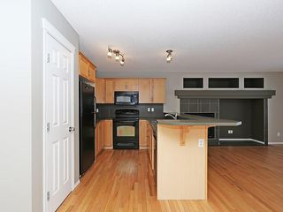 Photo 6: 89 SUNSET Heights: Cochrane House for sale : MLS®# C4177018