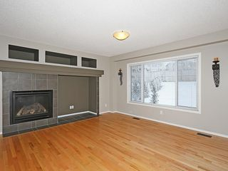 Photo 13: 89 SUNSET Heights: Cochrane House for sale : MLS®# C4177018
