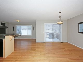 Photo 7: 89 SUNSET Heights: Cochrane House for sale : MLS®# C4177018