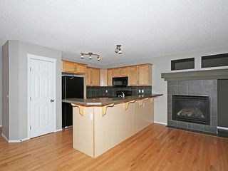 Photo 3: 89 SUNSET Heights: Cochrane House for sale : MLS®# C4177018