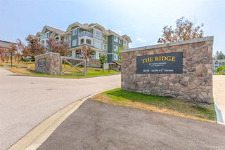 "Photo 1: 212 16398 64 Avenue in Surrey: Cloverdale BC Condo for sale in ""THE RIDGE AT BOSE FARMS"" (Cloverdale)  : MLS®# R2292995"