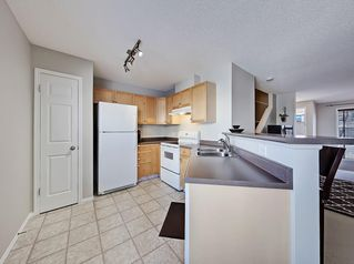 Photo 4: 138 PROMENADE Way SE in Calgary: McKenzie Towne Row/Townhouse for sale : MLS®# C4228502