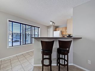Photo 9: 138 PROMENADE Way SE in Calgary: McKenzie Towne Row/Townhouse for sale : MLS®# C4228502