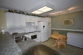Photo 4: 309 15340 19A Avenue in Surrey: King George Corridor Condo for sale (South Surrey White Rock)  : MLS®# R2419437