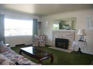 Photo 3: 2196 E 41ST Avenue in Vancouver: Killarney VE House for sale (Vancouver East)  : MLS®# V909660
