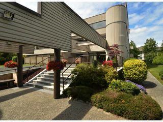 "Photo 1: 213 15275 19 Avenue in Surrey: King George Corridor Condo for sale in ""Village Terrace"" (South Surrey White Rock)  : MLS®# F1425373"