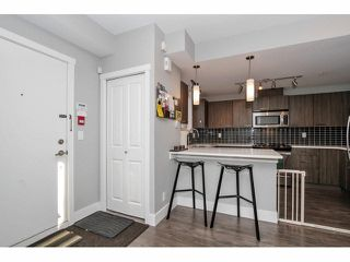 """Photo 2: 203 2110 ROWLAND Street in Port Coquitlam: Central Pt Coquitlam Townhouse for sale in """"AVIVA ON THE PARK"""" : MLS®# V1094259"""