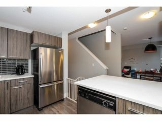 """Photo 5: 203 2110 ROWLAND Street in Port Coquitlam: Central Pt Coquitlam Townhouse for sale in """"AVIVA ON THE PARK"""" : MLS®# V1094259"""