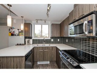 """Photo 4: 203 2110 ROWLAND Street in Port Coquitlam: Central Pt Coquitlam Townhouse for sale in """"AVIVA ON THE PARK"""" : MLS®# V1094259"""