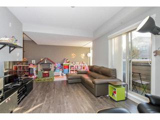 """Photo 9: 203 2110 ROWLAND Street in Port Coquitlam: Central Pt Coquitlam Townhouse for sale in """"AVIVA ON THE PARK"""" : MLS®# V1094259"""