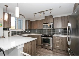 """Photo 3: 203 2110 ROWLAND Street in Port Coquitlam: Central Pt Coquitlam Townhouse for sale in """"AVIVA ON THE PARK"""" : MLS®# V1094259"""
