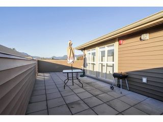 """Photo 18: 203 2110 ROWLAND Street in Port Coquitlam: Central Pt Coquitlam Townhouse for sale in """"AVIVA ON THE PARK"""" : MLS®# V1094259"""