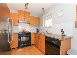 "Photo 7: 405 500 KLAHANIE Drive in Port Moody: Port Moody Centre Condo for sale in ""TIDES AT KLAHANIE"" : MLS®# V1142107"