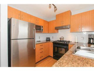 "Photo 8: 405 500 KLAHANIE Drive in Port Moody: Port Moody Centre Condo for sale in ""TIDES AT KLAHANIE"" : MLS®# V1142107"