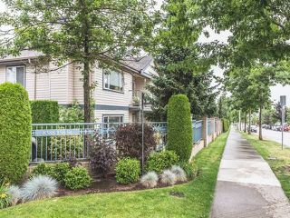 "Photo 1: 4 8388 158 Street in Surrey: Fleetwood Tynehead Townhouse for sale in ""SUMMERFIELD"" : MLS®# R2078252"