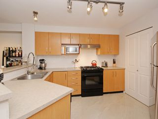 "Photo 9: 210 400 KLAHANIE Drive in Port Moody: Port Moody Centre Condo for sale in ""Klahanie"" : MLS®# R2149153"
