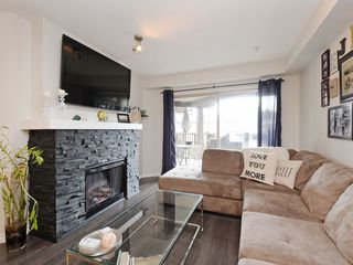 "Photo 2: 210 400 KLAHANIE Drive in Port Moody: Port Moody Centre Condo for sale in ""Klahanie"" : MLS®# R2149153"
