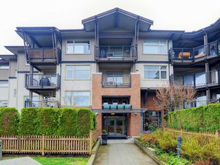 "Photo 1: 210 400 KLAHANIE Drive in Port Moody: Port Moody Centre Condo for sale in ""Klahanie"" : MLS®# R2149153"