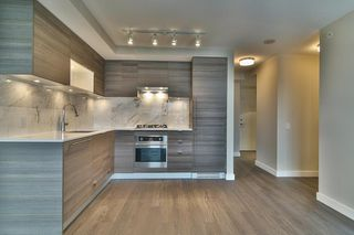 "Photo 1: 2204 602 COMO LAKE Avenue in Coquitlam: Coquitlam West Condo for sale in ""BOSA UPTOWN"" : MLS®# R2152144"