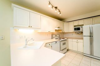"Photo 10: 1533 BOWSER Avenue in North Vancouver: Norgate Townhouse for sale in ""ILLAHEE"" : MLS®# R2230351"