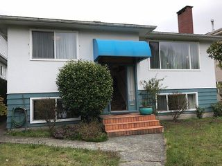 "Photo 1: 7870 ARGYLE Street in Vancouver: Fraserview VE House for sale in ""FRASERVIEW"" (Vancouver East)  : MLS®# R2249230"