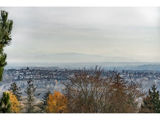 Main Photo: 156 2721 ATLIN Place in Coquitlam: Coquitlam East Townhouse for sale : MLS®# R2324465