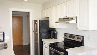 """Photo 2: 403 14820 104 Avenue in Surrey: Guildford Condo for sale in """"CAMELOT"""" (North Surrey)  : MLS®# R2370259"""