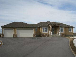 Main Photo: 89 RAVENCREST Drive in Rural Foothills M.D.: House for sale : MLS®# C3413988