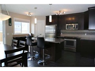Photo 5: 42 ELGIN MEADOWS Park SE in CALGARY: McKenzie Towne Residential Attached for sale (Calgary)  : MLS®# C3601180