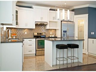 """Photo 6: 7697 211A Street in Langley: Willoughby Heights House for sale in """"YORKSON"""" : MLS®# F1408371"""