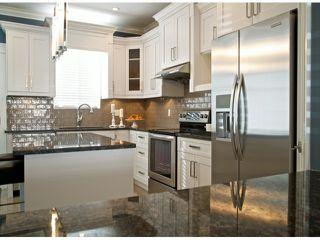 """Photo 4: 7697 211A Street in Langley: Willoughby Heights House for sale in """"YORKSON"""" : MLS®# F1408371"""