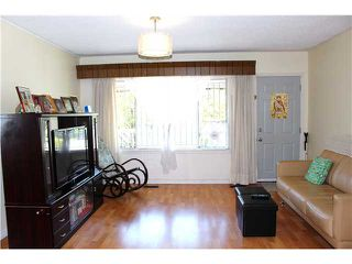 Photo 3: 5112 HOY Street in Vancouver: Collingwood VE House for sale (Vancouver East)  : MLS®# V1065249
