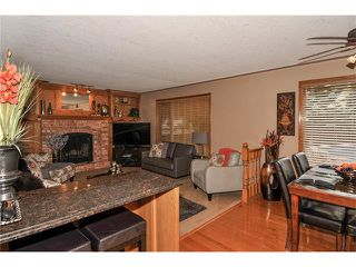 Photo 12: 39 SANDALWOOD Heights NW in Calgary: Sandstone House for sale : MLS®# C4025285