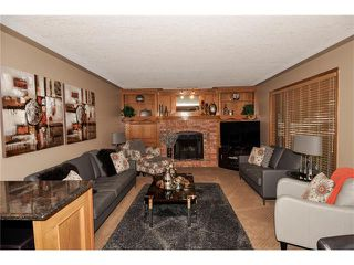 Photo 11: 39 SANDALWOOD Heights NW in Calgary: Sandstone House for sale : MLS®# C4025285
