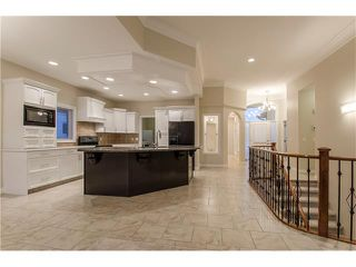 Photo 11: 129 SIMCOE Crescent SW in Calgary: Signal Hill House for sale : MLS®# C4106830