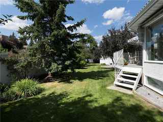 Photo 5: 33 PUMP HILL Landing SW in Calgary: Pump Hill House for sale : MLS®# C4133029