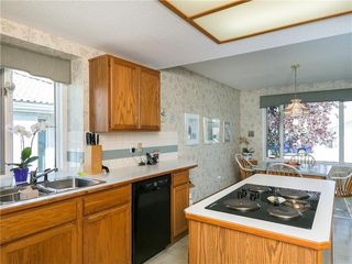 Photo 19: 33 PUMP HILL Landing SW in Calgary: Pump Hill House for sale : MLS®# C4133029