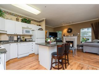 "Photo 9: 106 33502 GEORGE FERGUSON Way in Abbotsford: Central Abbotsford Condo for sale in ""Carina Court"" : MLS®# R2262879"