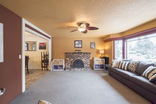 "Photo 2: 4469 202A Street in Langley: Langley City House for sale in ""BROOKSWOOD"" : MLS®# R2134697"