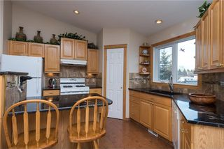 Photo 4: 71 Collins Crescent: Crossfield House for sale : MLS®# C4110216