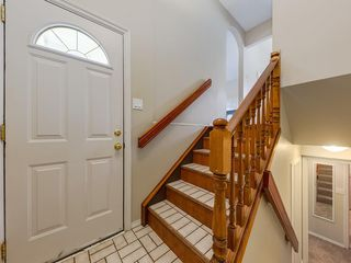 Photo 8: 11036 BRATON Place SW in Calgary: Braeside House for sale : MLS®# C4136035