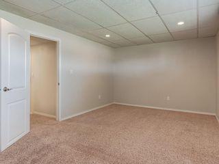 Photo 23: 11036 BRATON Place SW in Calgary: Braeside House for sale : MLS®# C4136035