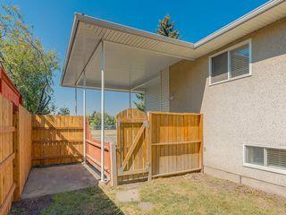 Photo 5: 11036 BRATON Place SW in Calgary: Braeside House for sale : MLS®# C4136035