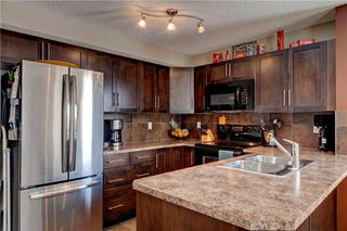 Photo 7: 67 105 DRAKE LANDING Common: Okotoks House for sale : MLS®# C4163815